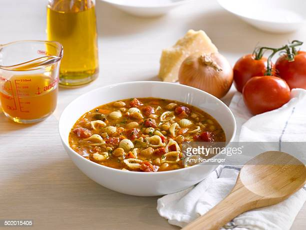 Minestrone soup in white bowl and it's ingredients
