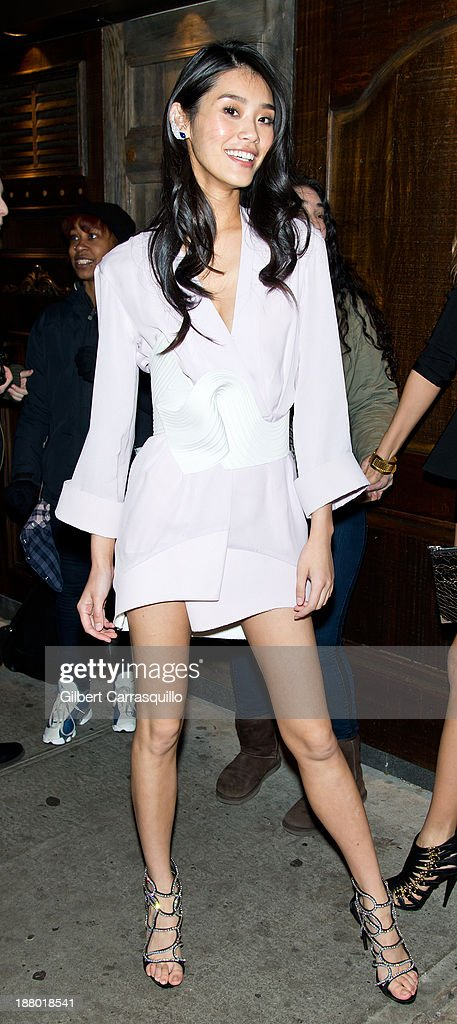 Ming Xi arrives at the 2013 Victoria's Secret Fashion Show at TAO Downtownon November 13, 2013 in New York City.