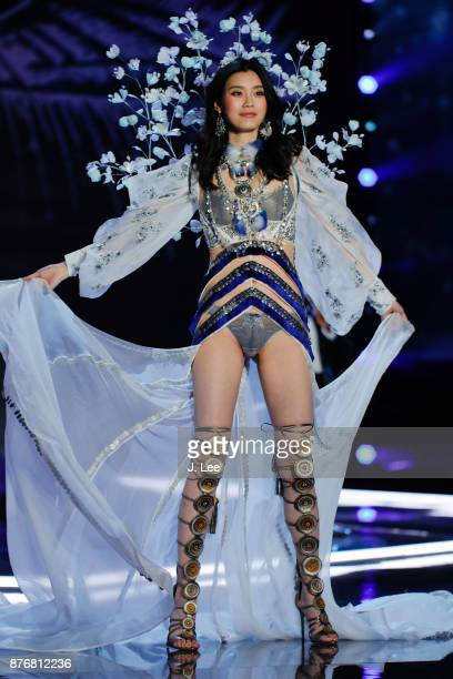 Ming Xi is helped up by Gizele Oliveira after Ming takes a fall at the 2017 Victoria's Secret fashion show on November 20 2017 in Shanghai China
