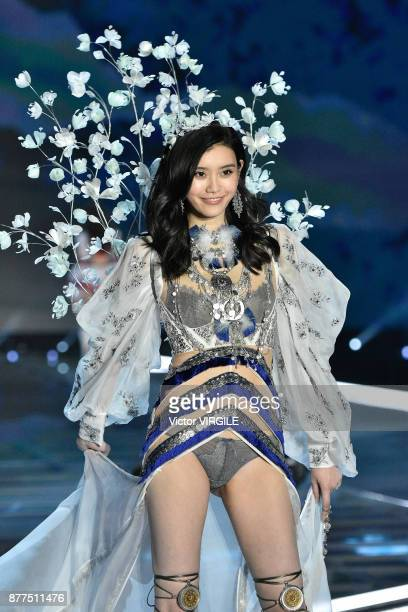 Ming Xi walks the runway at the 2017 Victoria's Secret Fashion Show In Shanghai Show at MercedesBenz Arena on November 20 2017 in Shanghai China
