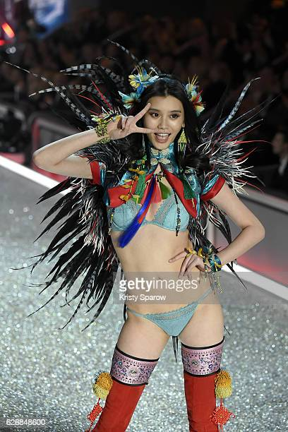 Ming Xi walks the runway during the Victoria's Secret Fashion Show on November 30 2016 in Paris France