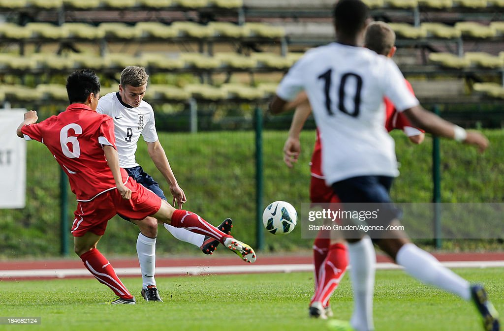 Ming Yang Yang of Switzerland and James Wilson of England in action during the UEFA U19 Championships Qualifier between England and Switzerland, on October 15, 2013 in Ptuj, Slovenia.