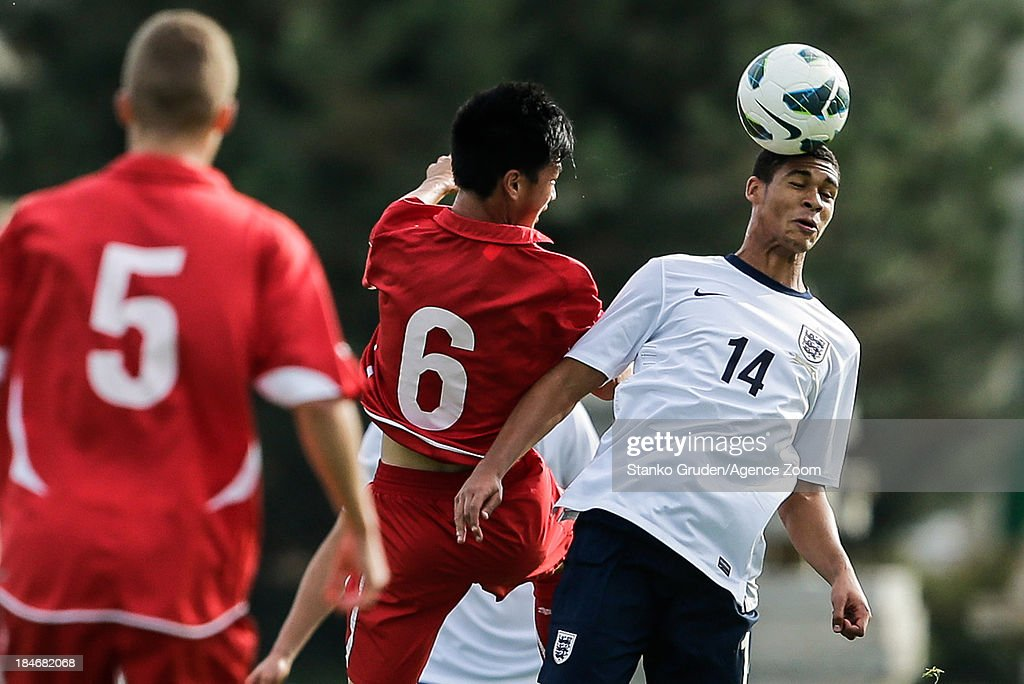 Ming Yang Yang of Switzerland and Robert Loftus-Cheek of England in action during the UEFA U19 Championships Qualifier between England and Switzerland, on October 15, 2013 in Ptuj, Slovenia.