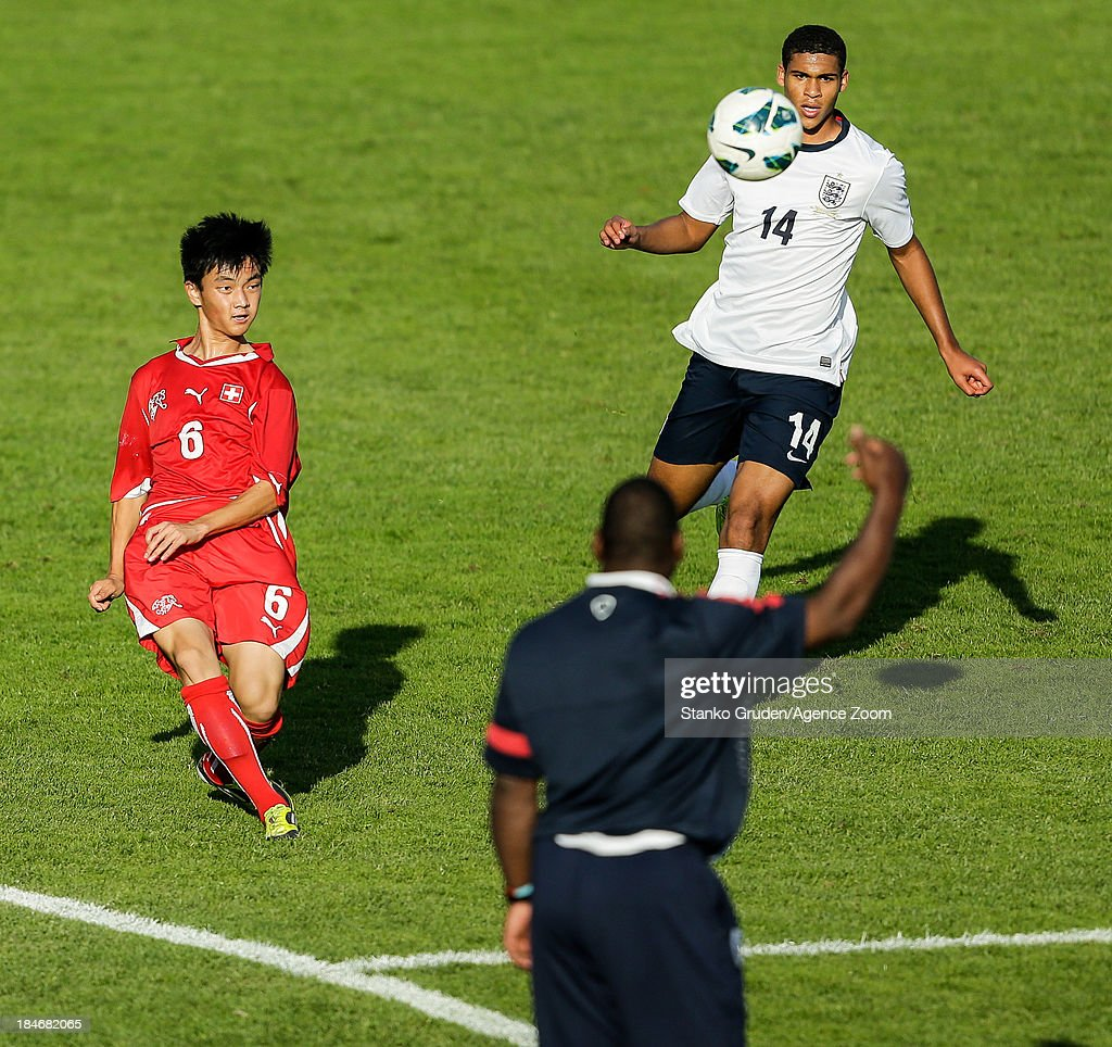 Ming Yang Yang of Switzerland and Ruben Loftus-Cheek of England in action during the UEFA U19 Championships Qualifier between England and Switzerland, on October 15, 2013 in Ptuj, Slovenia.