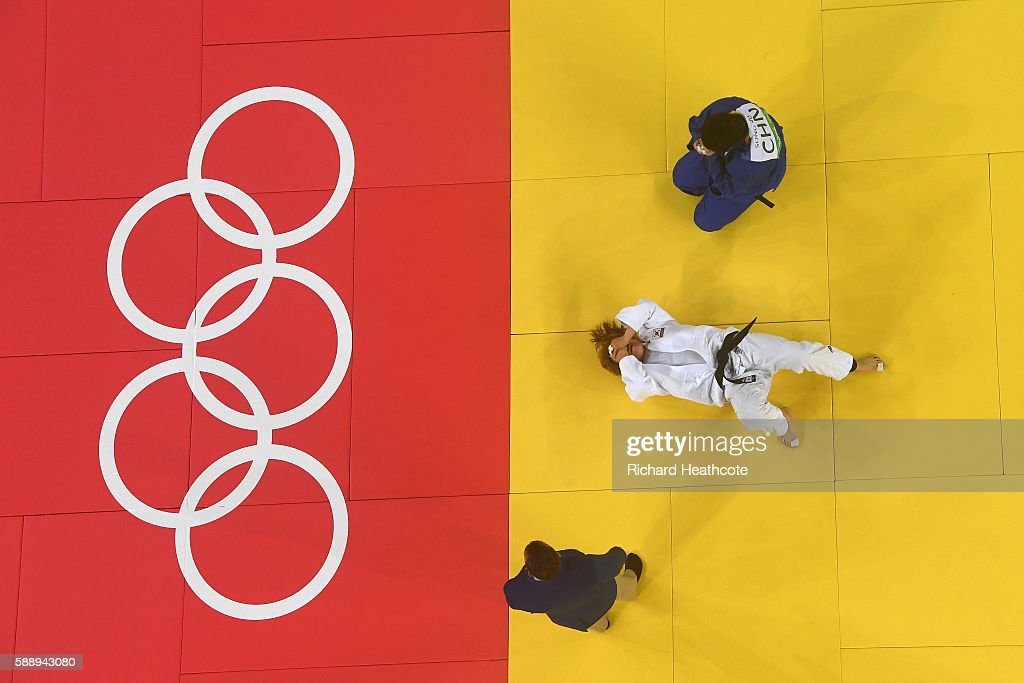 Mingeong Kim of South Korea and Sung Yu of China compete during the Women's 78kg Judo contest for Bronze Medal on Day 7 of the Rio 2016 Olympic Games...