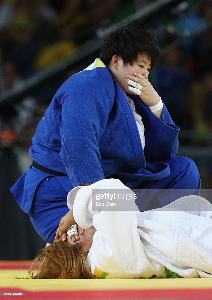 Mingeong Kim of South Korea and Sung Yu of China react during the Women's 78kg Judo contest for Bronze Medal on Day 7 of the Rio 2016 Olympic Games...