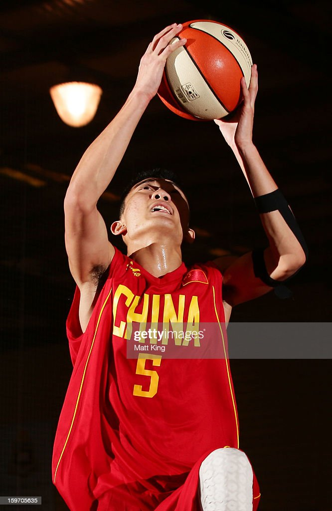 Minghui Sun of China drives to the basket in the bronze medal playoff game against Great Britain during day four of the Australian Youth Olympic Festival at Sydney Boys High School on January 19, 2013 in Sydney, Australia.