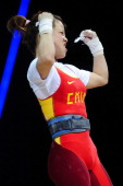 Mingjuan Wang of China celebrates in the Women's 48kg Group A weightlifting on Day 1 of the London 2012 Olympic Games at ExCeL on July 28 2012 in...