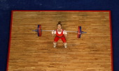 Mingjuan Wang of China competes in the Women's 48kg Weightlifting competition at the Dongguan Gymnasium during day one of the 16th Asian Games...