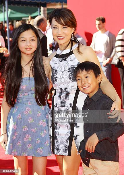 MingNa Wen and her children arrive at the Los Angeles premiere of 'The Lego Movie' held at Regency Village Theatre on February 1 2014 in Westwood...