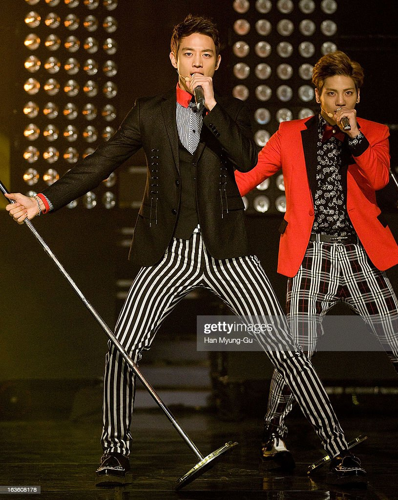 Minho and Jonghyun of South Korean boy band SHINee perform onstage during the MBC Music 'Show Champion' at Uniqlo-AX Hall on March 13, 2013 in Seoul, South Korea.