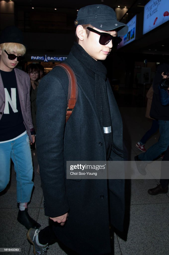 Min-Ho of SHINee is seen at Incheon International Airport on February 18, 2013 in Incheon, South Korea.