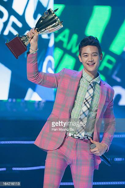 Minho of South Korean boy band SHINee gestures as he holds Trophy during the MBC Music 'Show Champion' at UniqloAX Hall on March 20 2013 in Seoul...