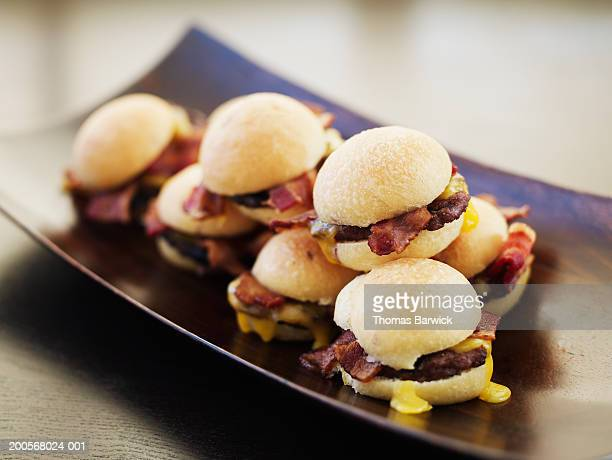 Mini bacon and cheddar burgers, close-up