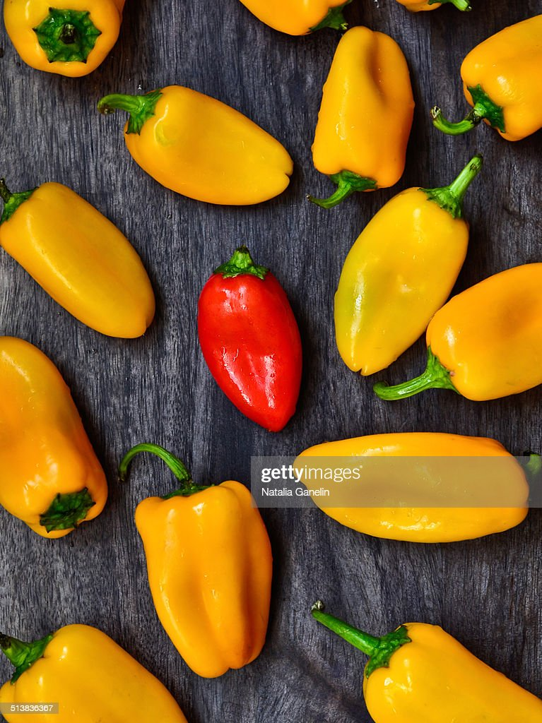 Mini bell peppers on a wooden board