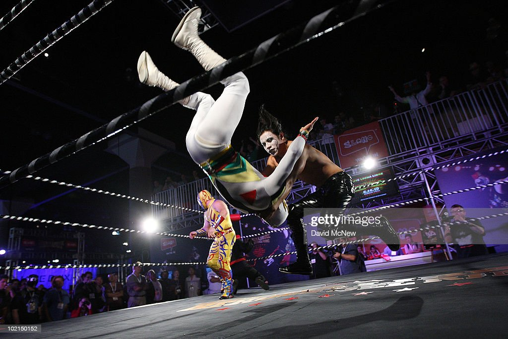Mini Charly Manson (R) throws Mascarita Sagrada as Lucha Libre, or Mexicon free-style, fighters known as luchadores perform to promote the Lucha Libre Heroes del Ring game in the Slang exhibit at the annual Electronic Entertainment Expo (E3) at the Los Angeles Convention Center on June 16, 2010 in Los Angeles, California. The Entertainment Software Association expects 45,000 people to attend the E3 expo featuring more than 250 gaming industry publishers and developers such as Nintendo, Microsoft and Sony.