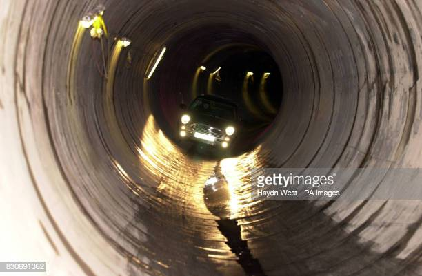 A Mini Cooper drives 20 metres through a Yorkshire Water sewerage tunnel beneath the streets of Hull in a stunt mirroring a scene from the Italian...