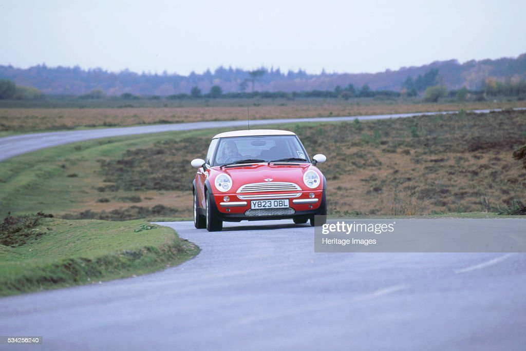 mini cooper driving on country road 2000 pictures getty images. Black Bedroom Furniture Sets. Home Design Ideas