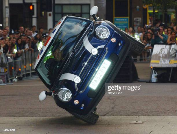 Mini Cooper goes up on two wheels during the premiere of 'The Italian Job' at the Empire Leicester Square September 15 2003 in London England