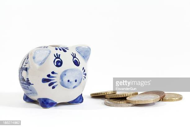 mini delftware piggy bank with coins