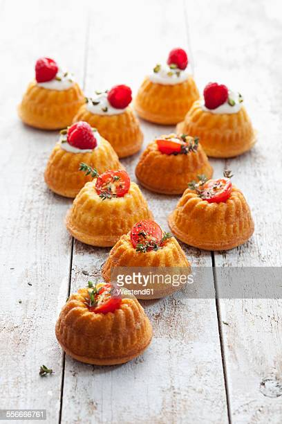 Mini Gugelhupf filled with cream cheese and ricotta garnished with tomato and marjoram or raspberry and pistachio