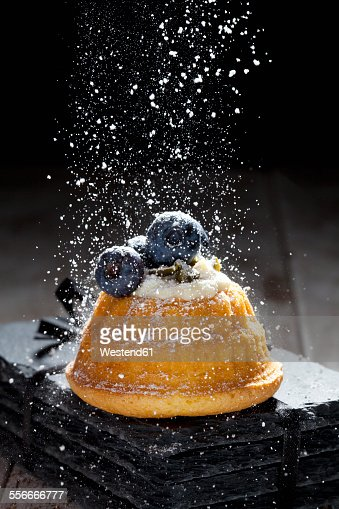 Mini Gugelhupf filled with ricotta and cream cheese garnished with blueberries