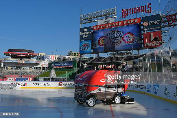 A mini ice resurfacing machine conditions the ice before a practice session for the NHL Winter Classic between the Washington Capitals and the...