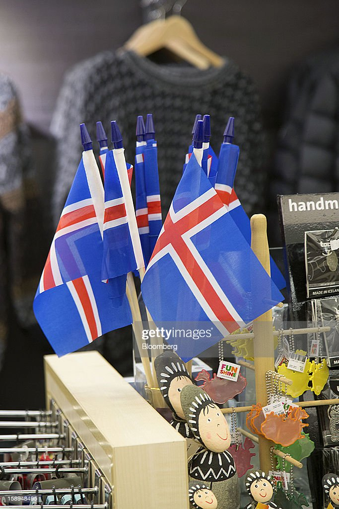 Mini Icelandic national flags sit for sale at a store in Reykjavik, Iceland, on Wednesday, Jan. 2, 2013. Creditors of Iceland's three biggest failed banks are fighting for a waiver to krona controls imposed in 2008 amid risks pay-outs will be delayed beyond 2015. Photographer: Arnaldur Halldorsson/Bloomberg via Getty Images