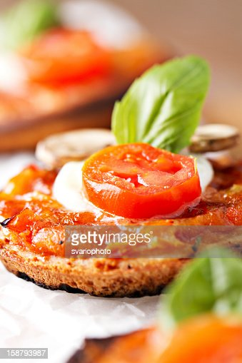 Mini pizza margherita. : Stock Photo