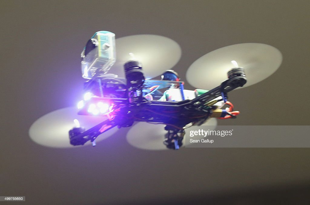 A mini quadcopter drone meant for FPV racing flies in a hall during a gathering of drone enthusiasts on December 2 2015 in Berlin Germany Drone...