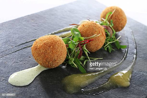 mini scotch egg appetizer on slate platter