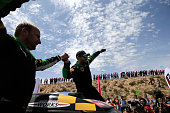 Mini team driver Yazeed Mohamed alRahji and copilot Timo Gottschalk celebrate after finishing in second place of the Silkway rally at the end of the...
