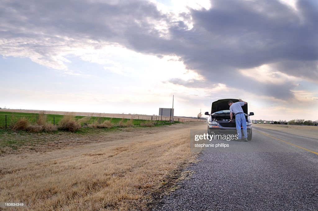 Mini Van with Car Trouble on a Small Rural Highway