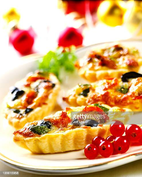 Mini vegetable quiches on white plate