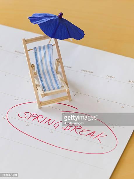 Miniature beach chair and calendar