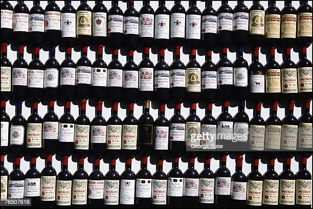 Miniature bottle magnets shaped to look like famous wine producers are viewed in this 2003 Bordeaux France photo