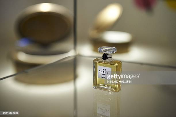 A miniature bottle of Chanel No 5 perfume forms part of an installation dedicated to the fragrance during a pressview of 'Mademoiselle Privé' a joint...