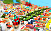 Creative abstract GPS satellite navigation, travel, tourism and location route planning business concept: 3D render illustration of the macro view of miniature color city map with 3D buildings with se