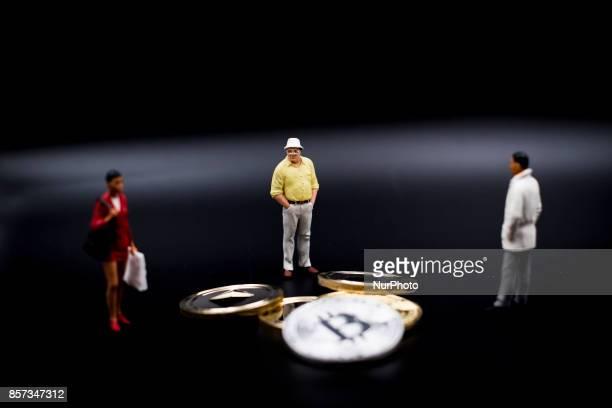 Miniature figures near Bitcoin and Litecoin Coin