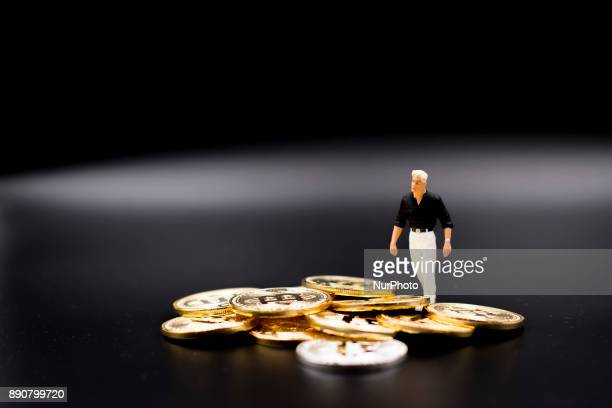 Miniature figures near Bitcoin physical coin Futures on Bitcoins increased by more than 20% after their American debut on the Chicago Cboe Futures...