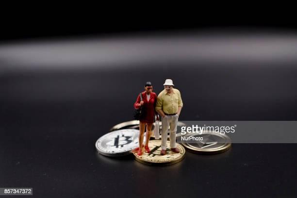 Miniature figures near Bitcoin physical token