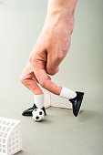 Miniature football game with human fingers
