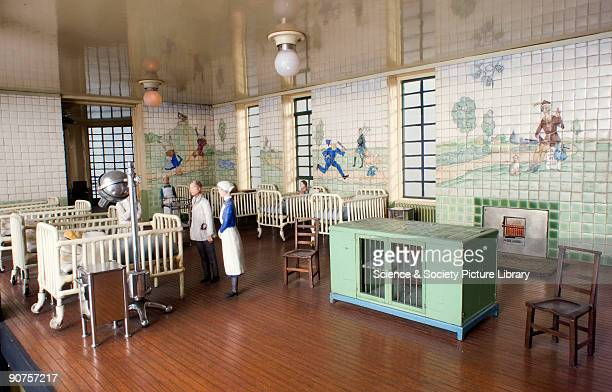 Miniature hospital scale 116 made for publicity for King Edward's Hospital Fund for London The ward has been decorated with a tiled mural with scenes...