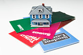 Miniature house and bank loan brochures