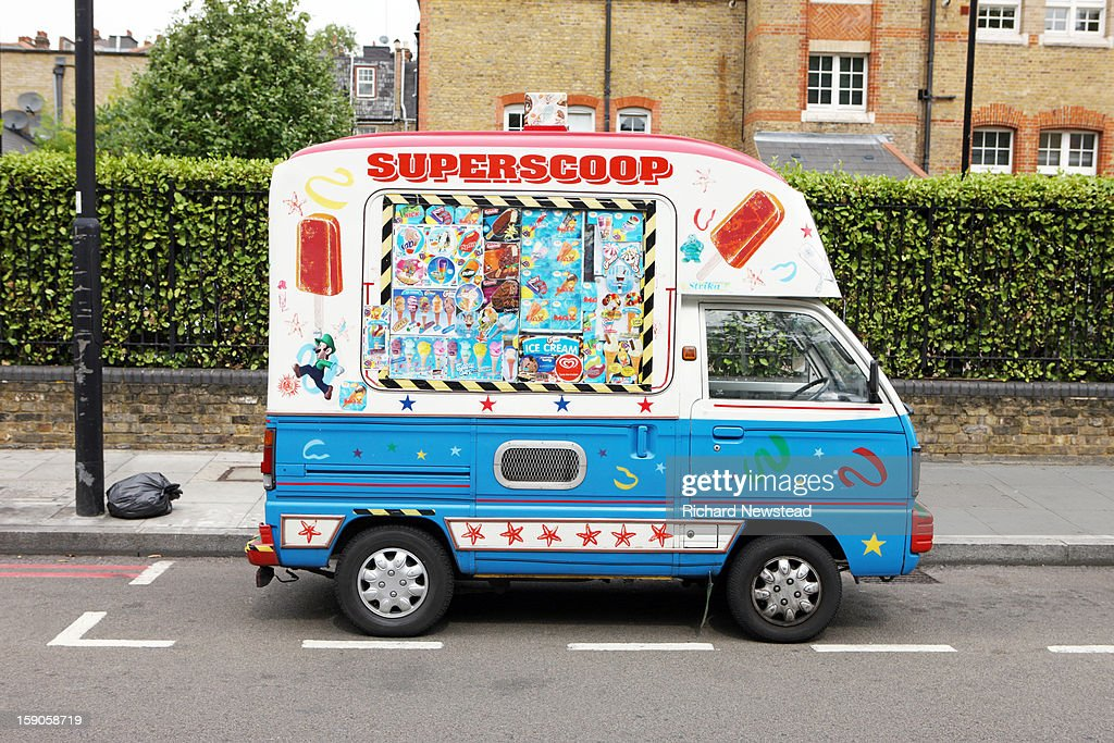 CONTENT] Miniature ice cream van on South London street.