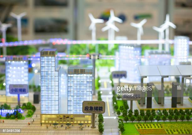 A miniature model of a city powered by alternative energy on the exhibition floor during the Intersolar North America Conference in San Francisco...