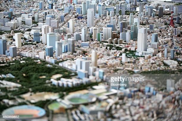 A miniature model of Mori Building Co's Toranomon Hills center top is displayed on a diorama of the city during a media preview of the Toranomon...