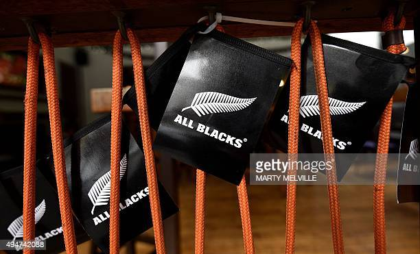 Miniature New Zealand All Blacks rugby team flags are displayed in a bar in Wellington on October 29 ahead of the Rugby World Cup final match between...