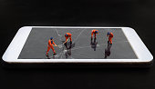 miniature people repair or survey smartphone crack
