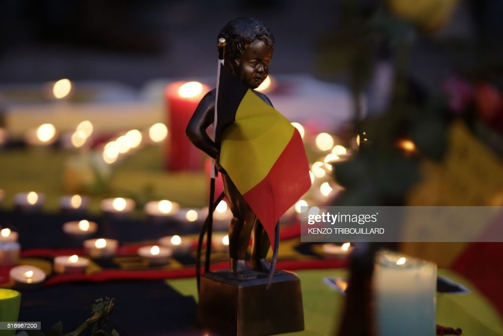 A miniature sculpture of Brussels' landmark Manneken Pis is seen in tribute to victims at a makeshift memorial in front of the stock exchange at the...